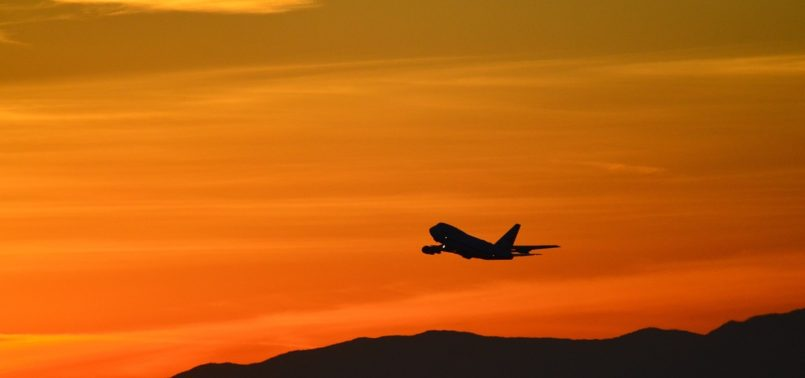 airplane in sunset